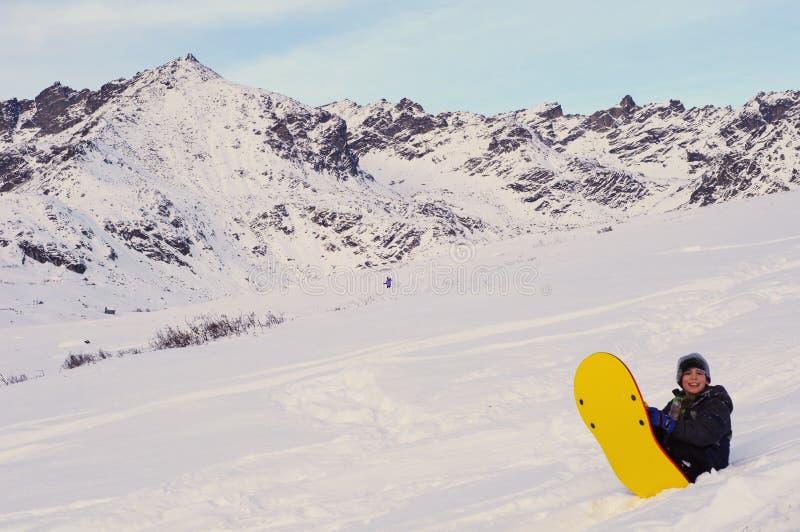 chłopiec sledding obraz stock