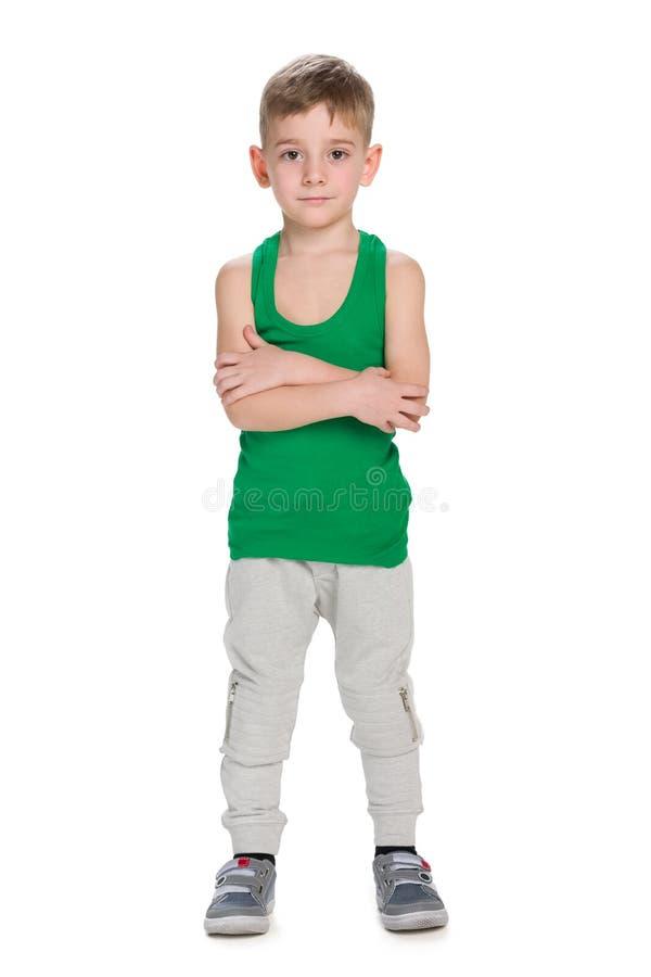 Chłopiec stojaki na białym tle zdjęcie stock