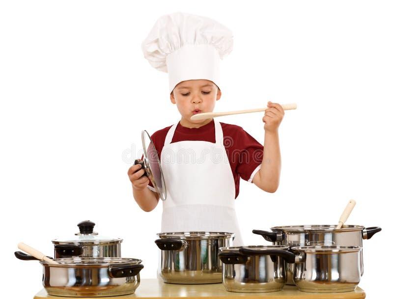 chłopiec szef kuchni kapeluszowy bawić się obraz stock