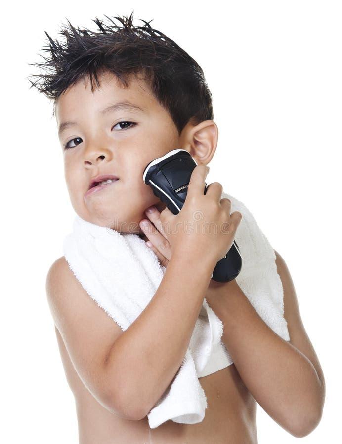 chłopiec udaje ogolenie zdjęcia royalty free