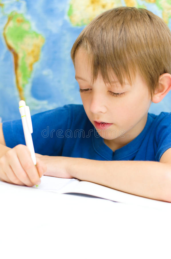 Chłopiec writing fotografia royalty free