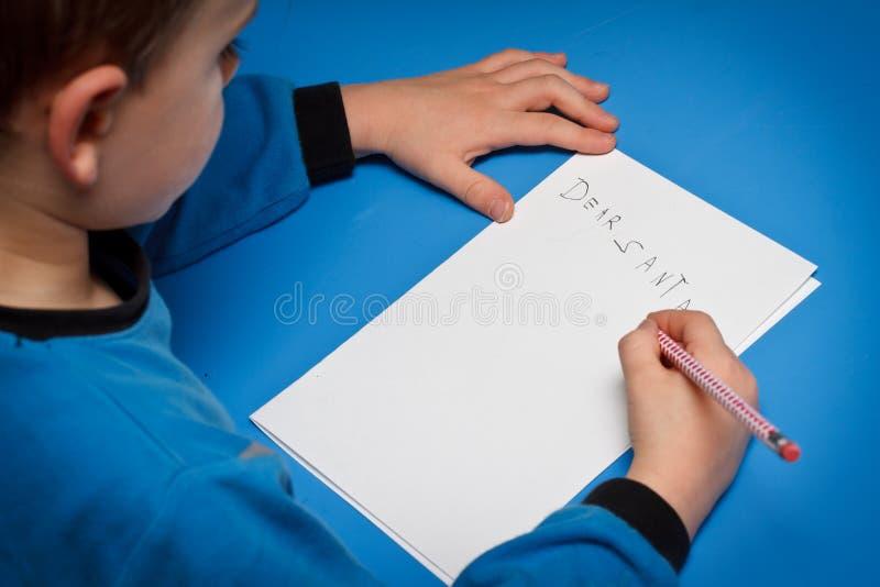 chłopiec writing Santa obraz royalty free