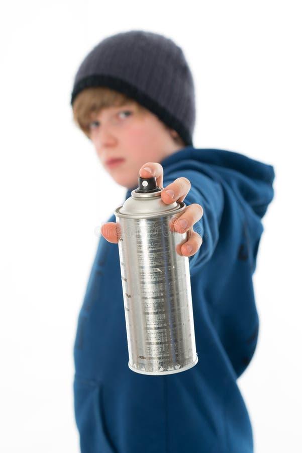 Chłopiec z aerosol puszką zdjęcia stock