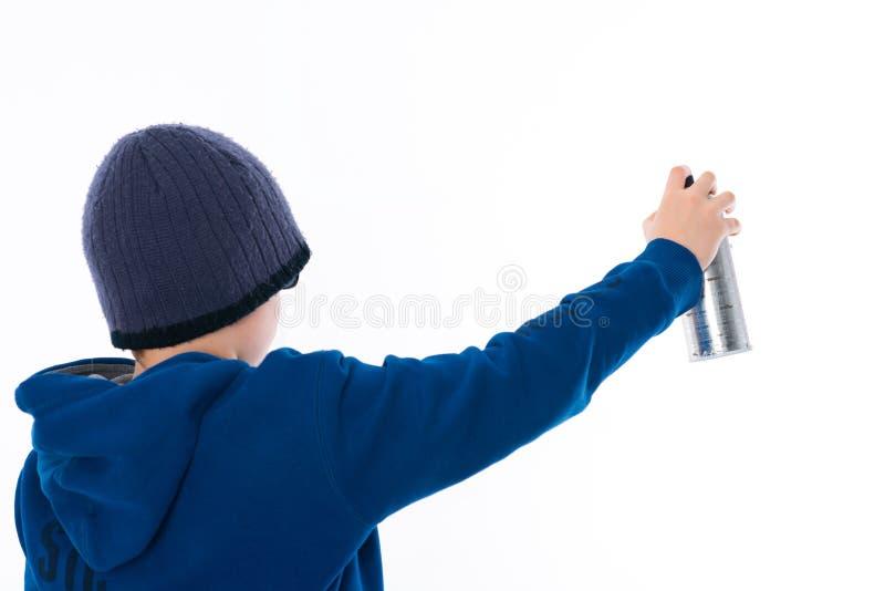Chłopiec z aerosol puszką fotografia stock
