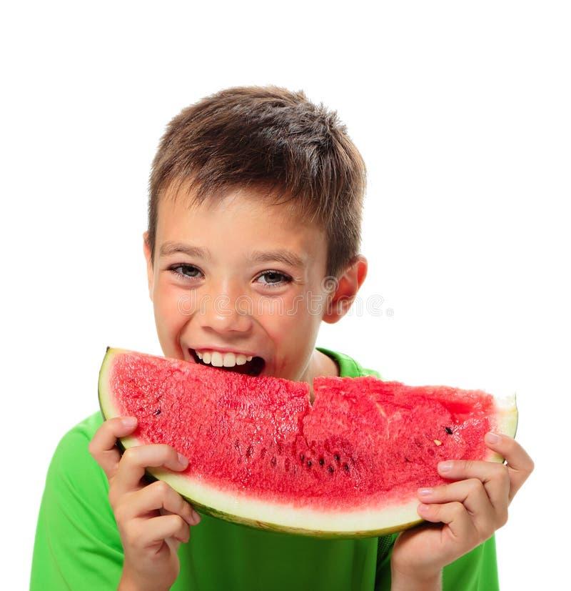 Chłopiec z arbuzem obrazy royalty free