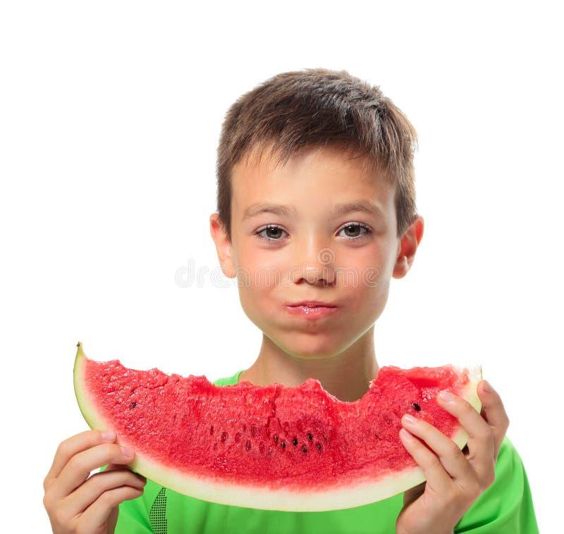 Chłopiec z arbuzem fotografia stock