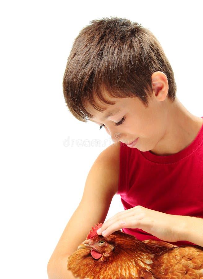 Chłopiec z karmazynką fotografia royalty free