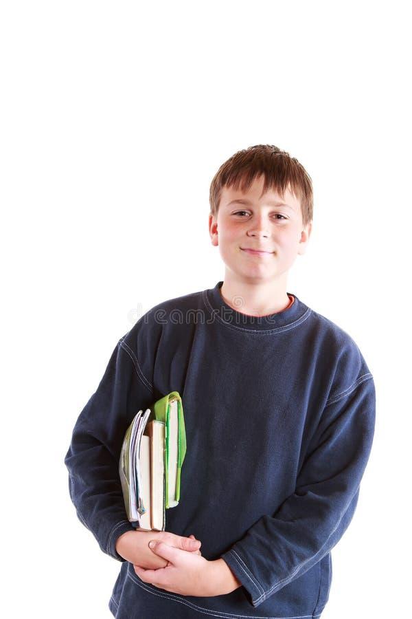 Chłopiec z książkami zdjęcia royalty free