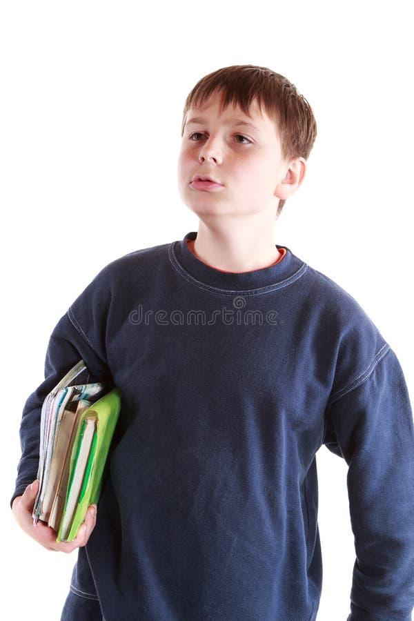Chłopiec z książkami obrazy royalty free
