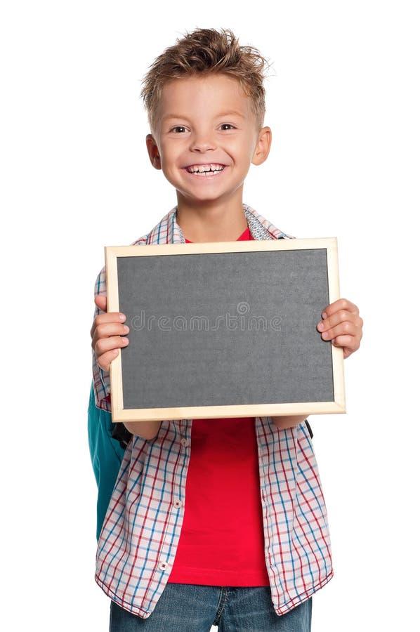 Chłopiec z małym blackboard zdjęcia stock