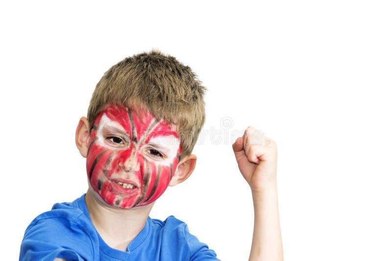 Chłopiec z malującą twarzą obraz stock
