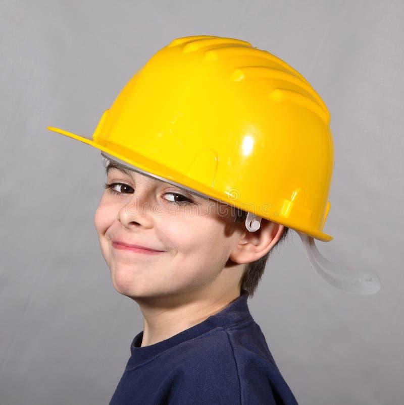 Chłopiec z pokojowym spojrzenia i ochrony hełmem fotografia royalty free