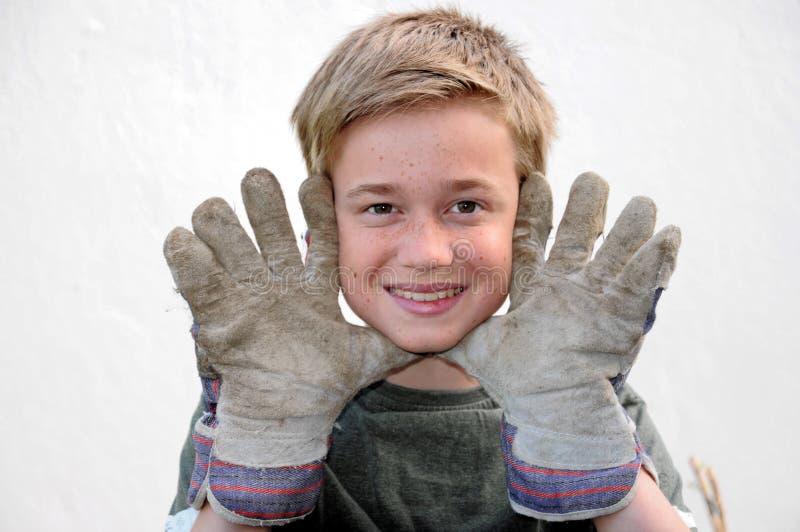 Chłopiec z prac rękawiczkami obrazy royalty free