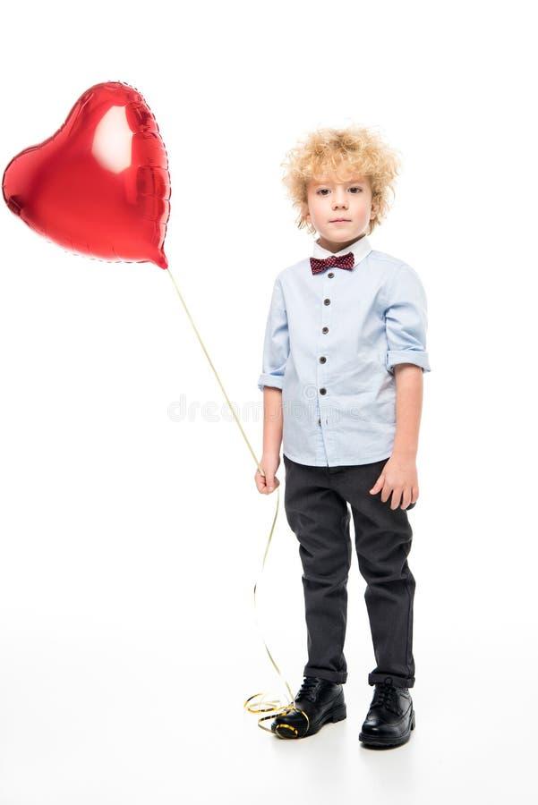 Chłopiec Z serce Kształtującym balonem obraz stock
