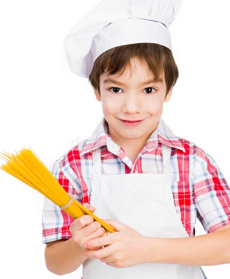 Chłopiec z spaghetti obraz royalty free