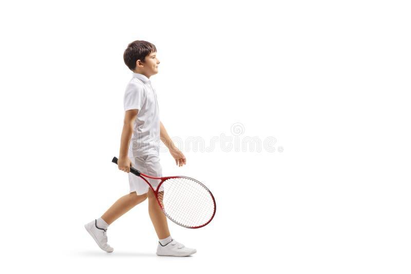 Chłopiec z tenisowego kanta odprowadzeniem fotografia royalty free