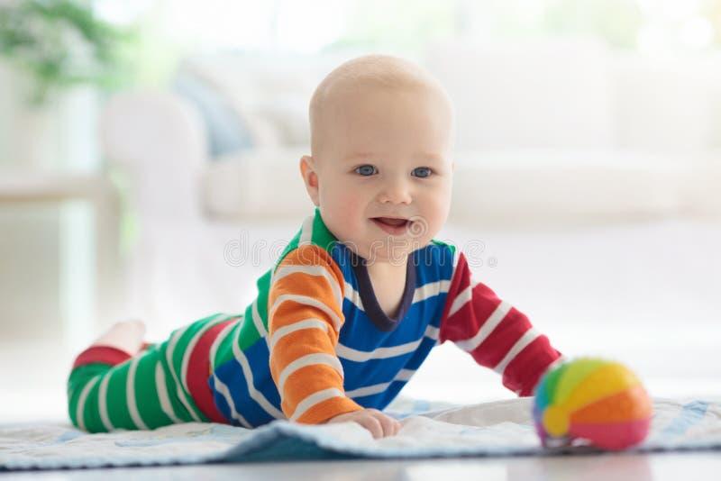 Chłopiec z zabawkami i piłką fotografia royalty free