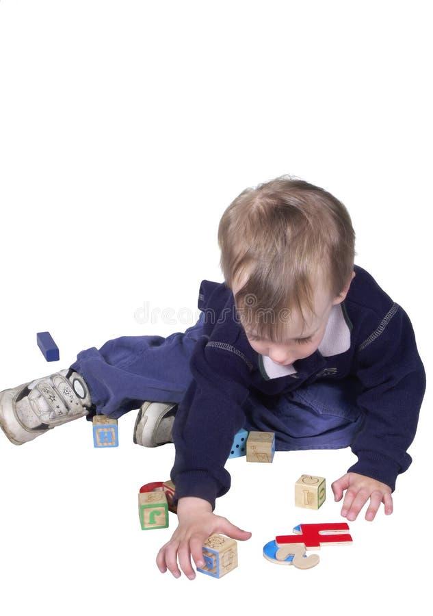 Download Chłopak gra obraz stock. Obraz złożonej z learn, odosobnienie - 134533