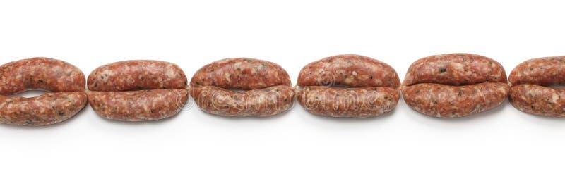 Chaîne des saucisses crues images libres de droits