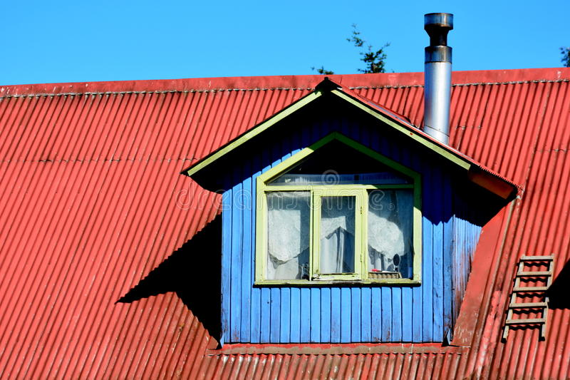 Chacao, Chiloe. Dormer or roof window in a house of Chacao, Chiloe, Chile royalty free stock photo