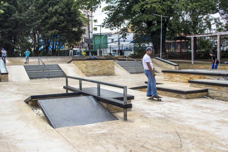 Chacara do Jockey Park. Sao Paulo, SP, Brazil, November 06, 2016. SYoung Skateboarder while performing skateboarding on the edge at skate park of the Chacara do royalty free stock photo