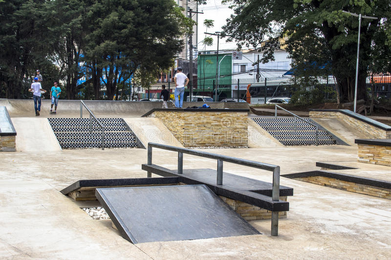 Chacara do Jockey Park. Sao Paulo, SP, Brazil, November 06, 2016. Young Skateboarder while performing skateboarding on the edge at skate park of the Chacara do stock photography