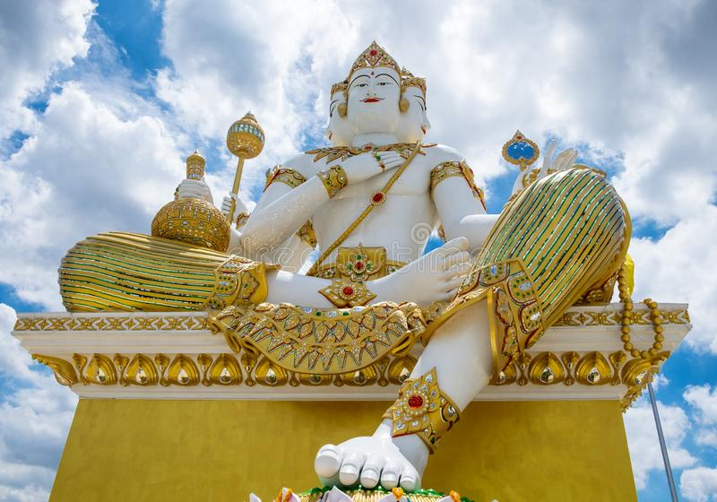 Chachoengsao,Thailand - Aug 24 2015 : God brahma large statue in front and blue sky in wat saman rattanaram stock photos