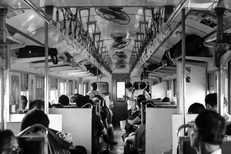 CHACHOENGSAO, THAILAND - MARCH 13, 2016: Black and white picture of passengers. On the train royalty free stock photo