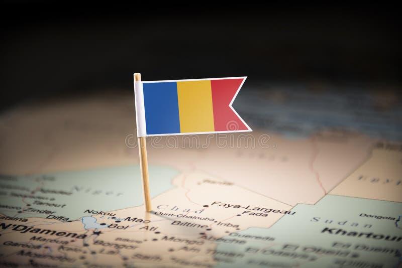 Chad marcado con una bandera en el mapa fotos de archivo libres de regalías