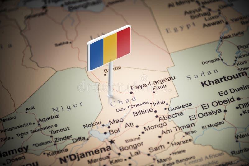 Chad marcado con una bandera en el mapa fotografía de archivo