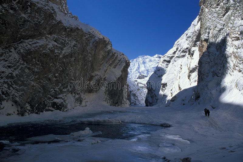 Chaddar hikers. Hiker on the frozen Zanskar river (Chaddar), Ladakh, India stock photos