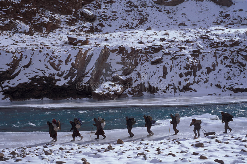 Chaddar hikers. Hiker on the frozen Zanskar river (Chaddar), Ladakh, India royalty free stock images