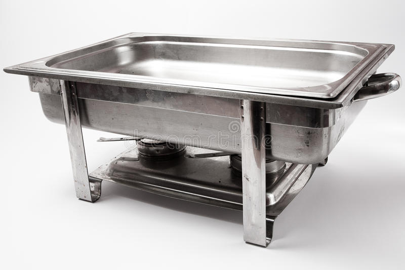 Chafing dish. Metal chafing dish on white background stock photos
