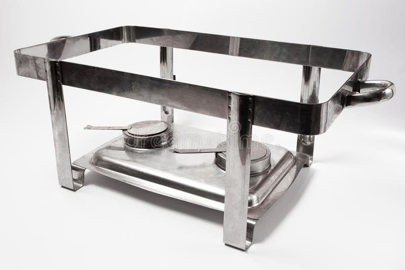 Chafing dish. Metal chafing dish on white background royalty free stock images