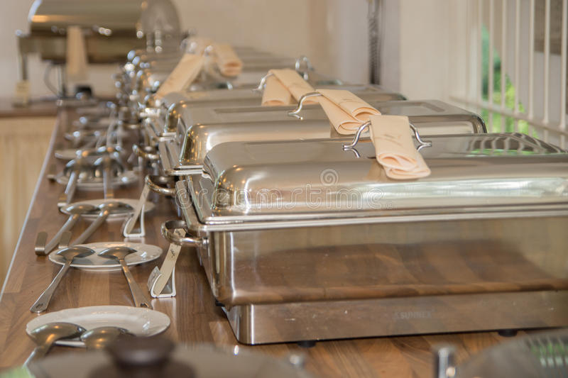 Chafing dishes. A row of chafing dishes royalty free stock images