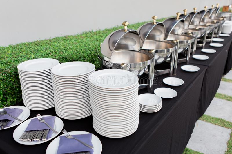 Chafing dishes on the table at the banquet. Chafing dishes on the table at the luxury banquet stock photos
