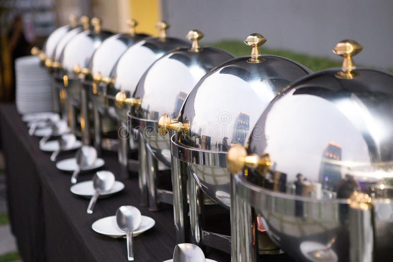 Chafing dishes on the table. At the luxury banquet royalty free stock images