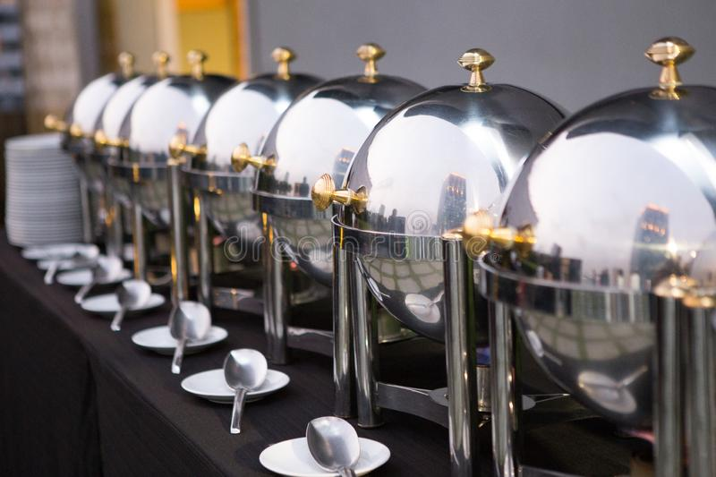 Chafing dishes on the table. At the luxury banquet royalty free stock photography
