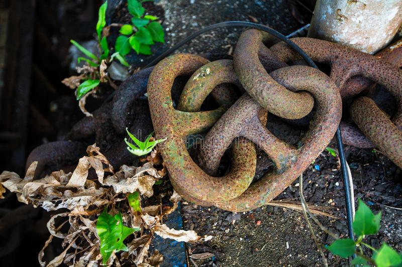 Chain on an abandoned building stylized as a huge ship in the jungle of the Islands of the Gulf stock photos