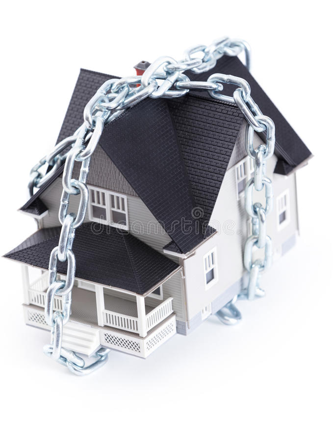 Chain around the house architectural model. Real estate concept - chain around the house architectural model stock photography