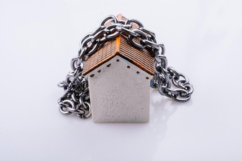 Chain around a Little model house in view. Chain around a little model house in the view stock photography