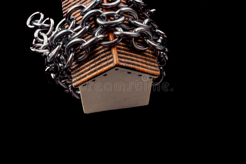Chain around a Little model house in view. Chain around a little model house in the view royalty free stock photos