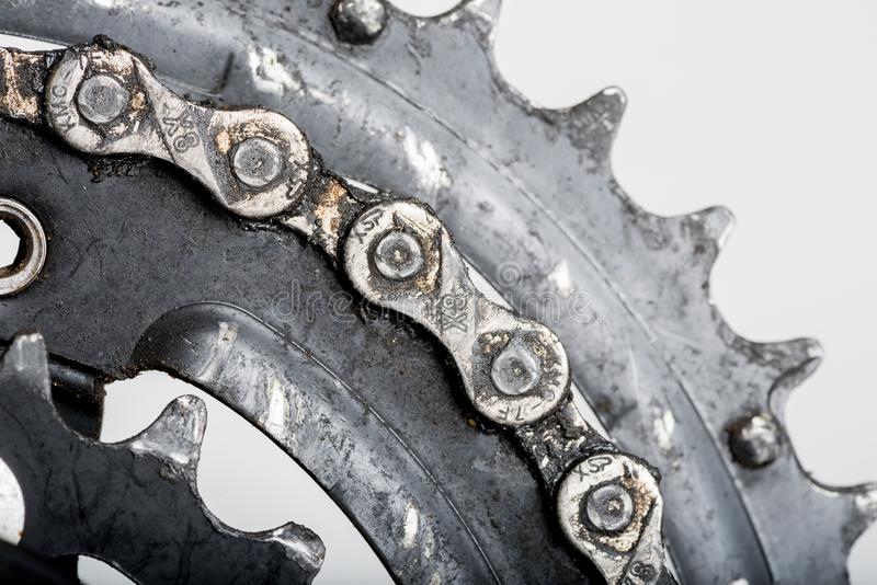 Chain of a bicycle close up smeared with engine oil. On a gray background royalty free stock image