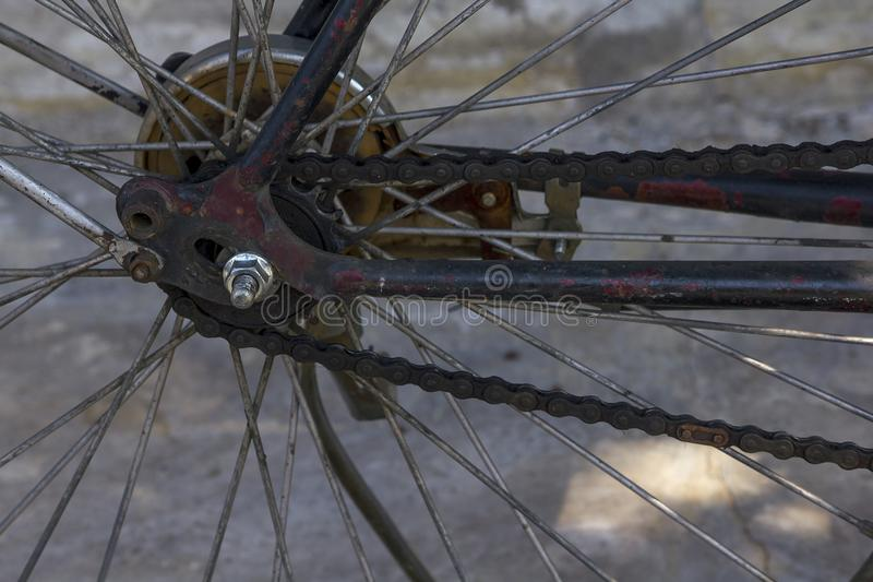 Bike chains and old parts stain the oil. The chain of bicycles stains the oil. And a piece of old rusty bike royalty free stock photos