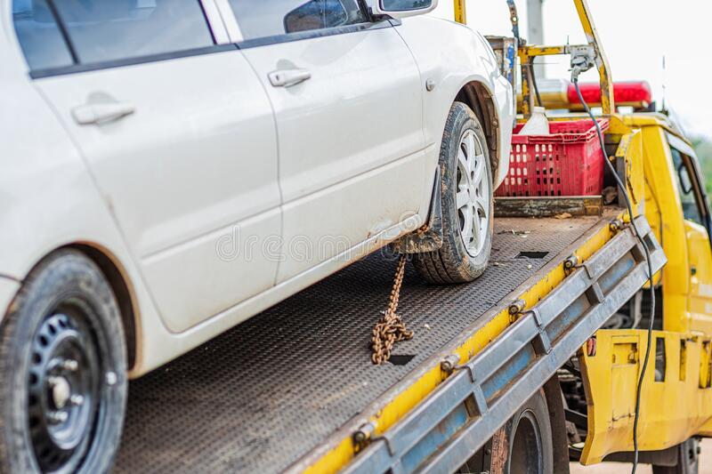 Chain bind car wheel on car tow in the park. Damage and accident  car. The chain bind car wheel on car tow in the park. Damage and accident  car royalty free stock photo