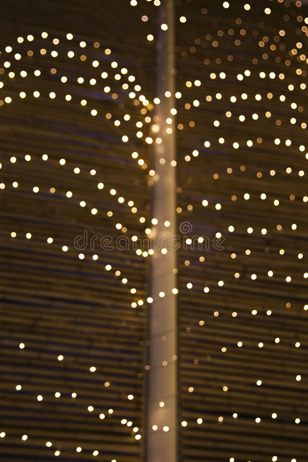 Chain of bokeh lights Christmas background. Festive concept. Place for design, vertical photo stock photo