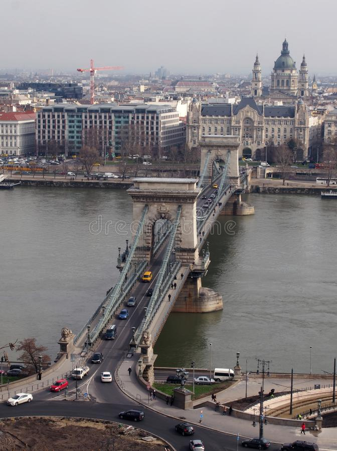 The chain bridge in budapest with the river danube and parliament buildings with view of the city royalty free stock photography