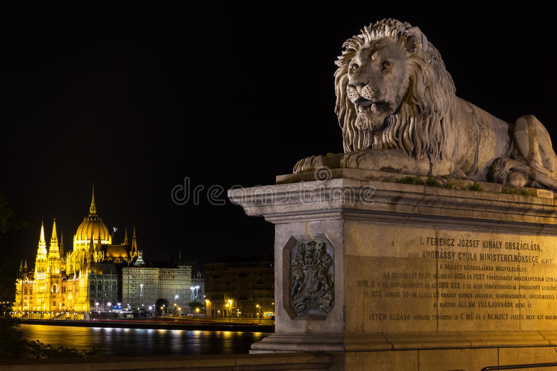 Chain Bridge Budapest and a view on Parliament. The Széchenyi Chain Bridge (Hungarian: Széchenyi lánchíd) is a suspension bridge that spans the River royalty free stock photography