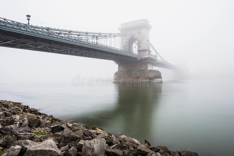Download Chain Bridge Over The Danube And A Boat, Budapest, Hungary, In  Fog, Evening Lights Stock Photo - Image of evening, hungary: 71443568