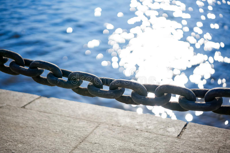 Chain on the dock stock images